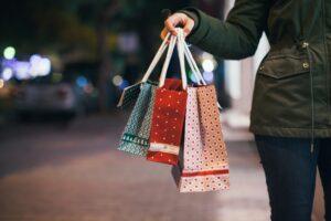 girl carrying a shopping bags